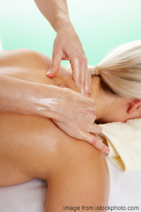 Massage is a popular holistic therapy. This shows a woman receiving a shoulder massage.